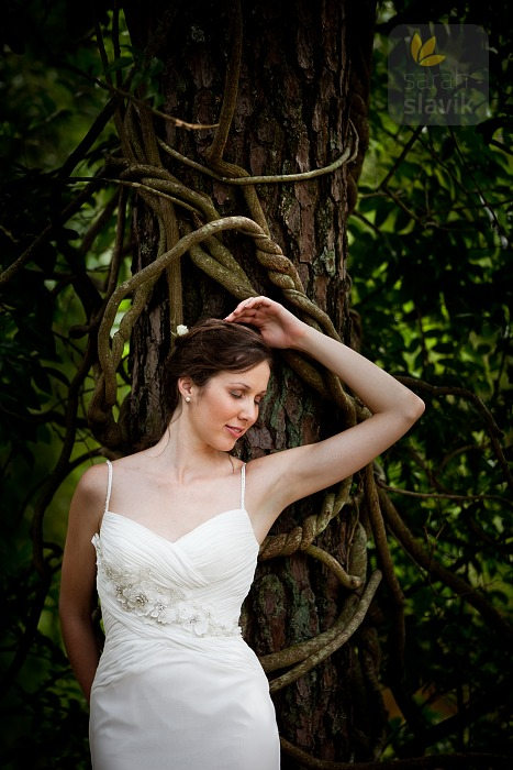 Bride by a tree with wine