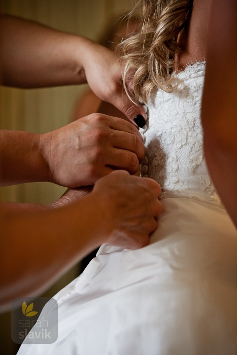 Buttoning up the Wedding Dress