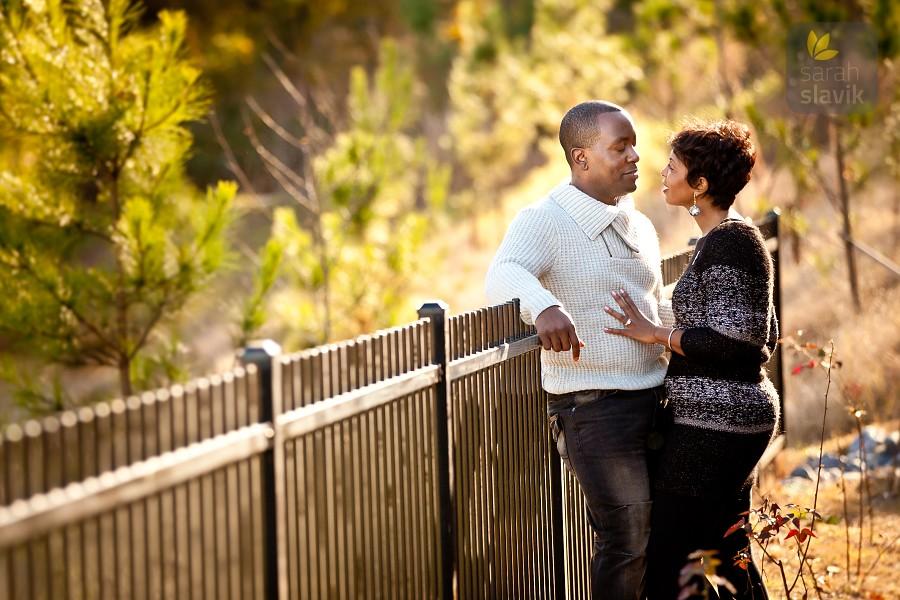 Engagement Portrait by a Fence