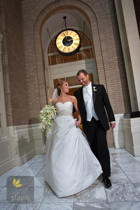 Bride and groom with clock