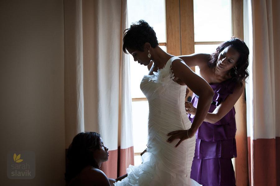 Bride puts her dress on