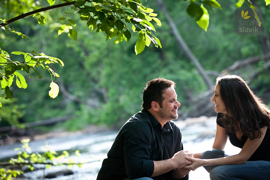 Engaged couple on a river