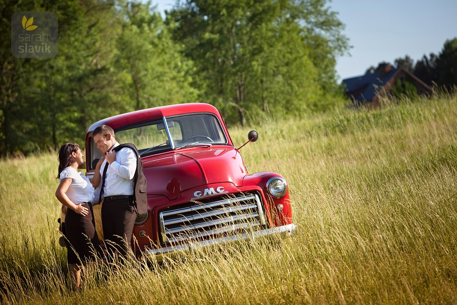 Engaged couple with a vintage truck