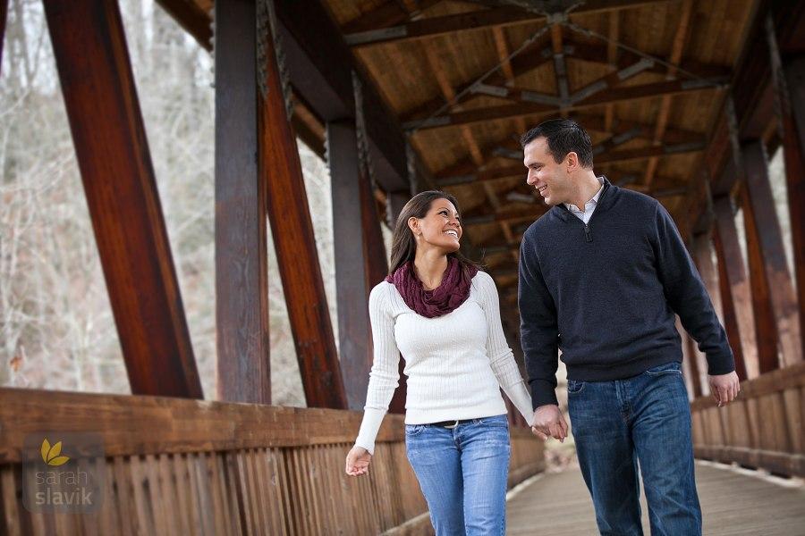 Engagement portrait on a bridge