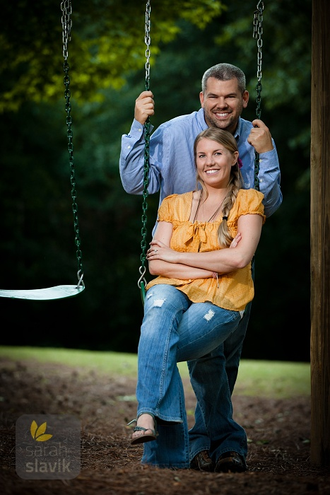 Engagement portrait on a swing