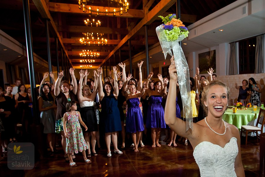 Happy bride bouquet toss