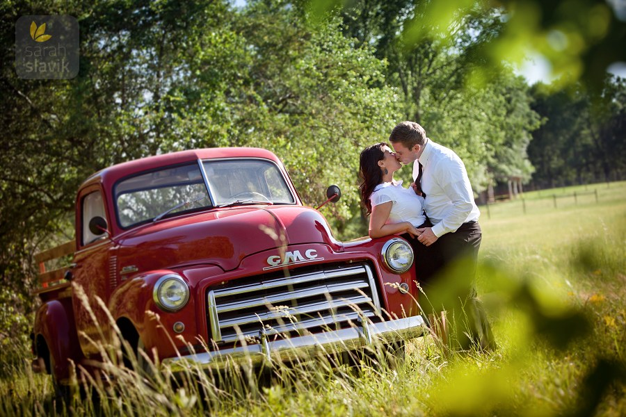 Kissing couple with a truck