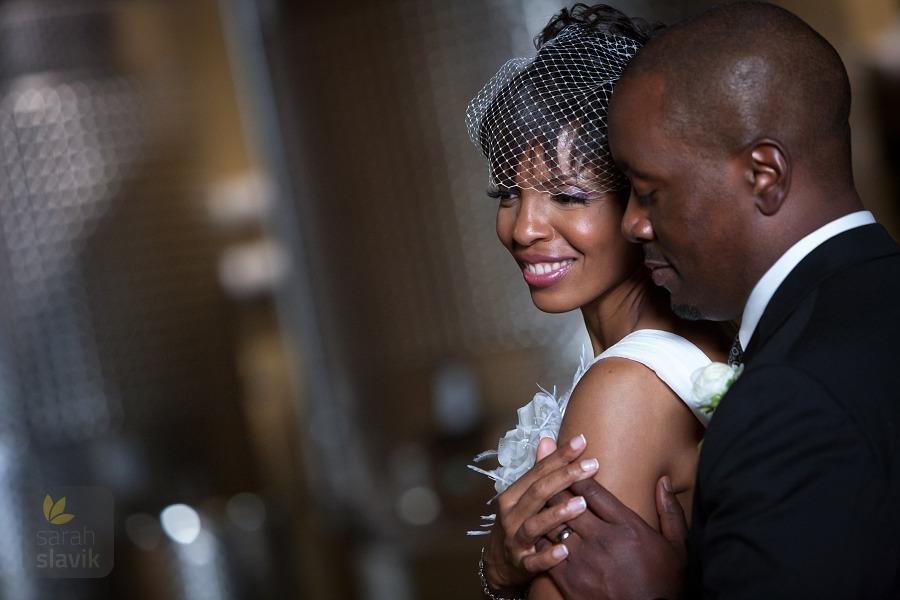 Wedding couple with wine tanks